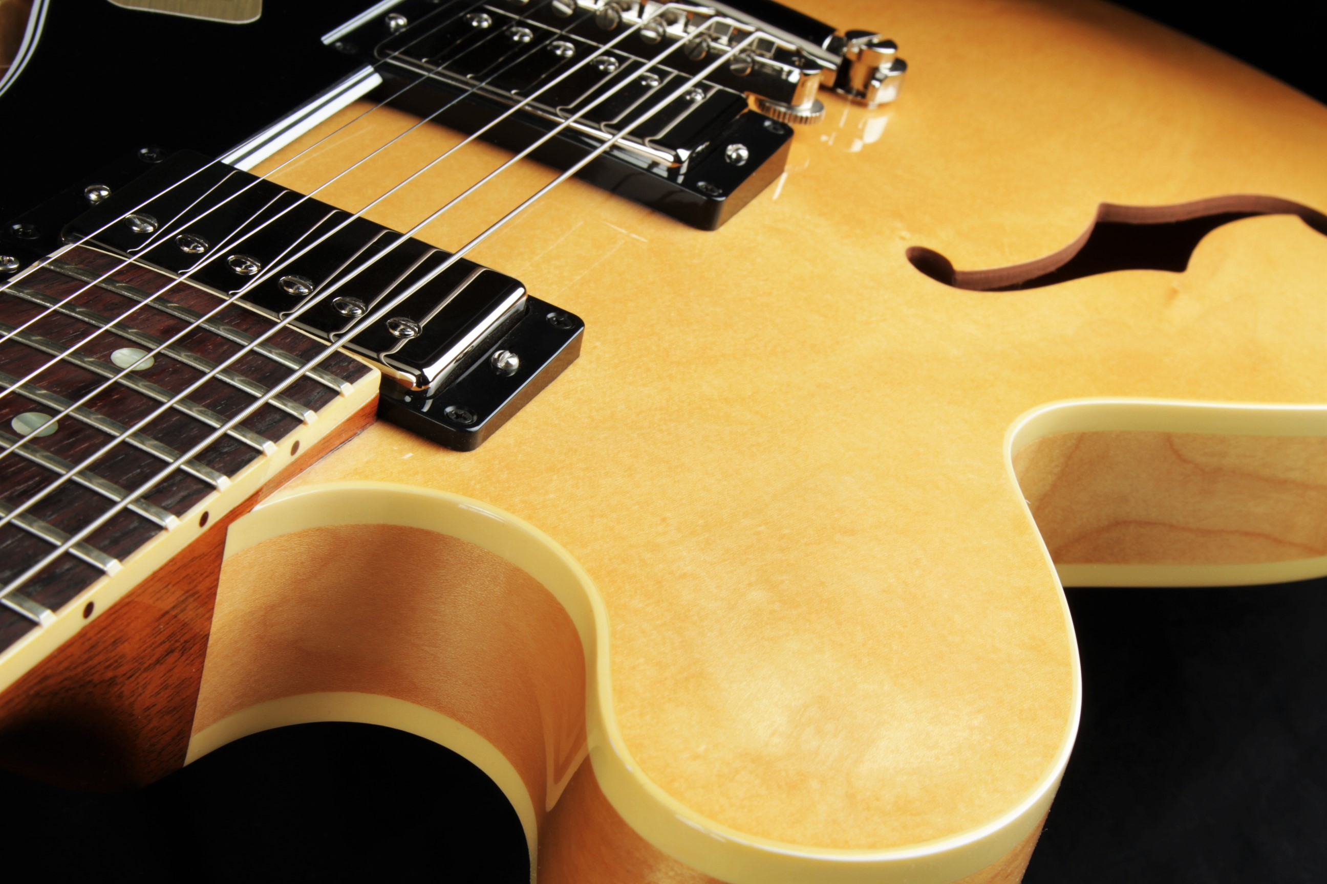 Semi-Hollow Body Electric Guitars